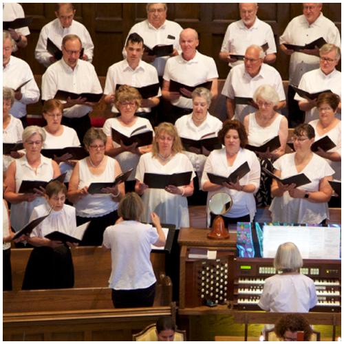 All women summer choir singing from choir loft