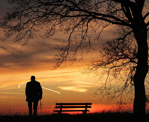 Person silhouetted against sunset