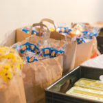 Brown paper bags filled with bread