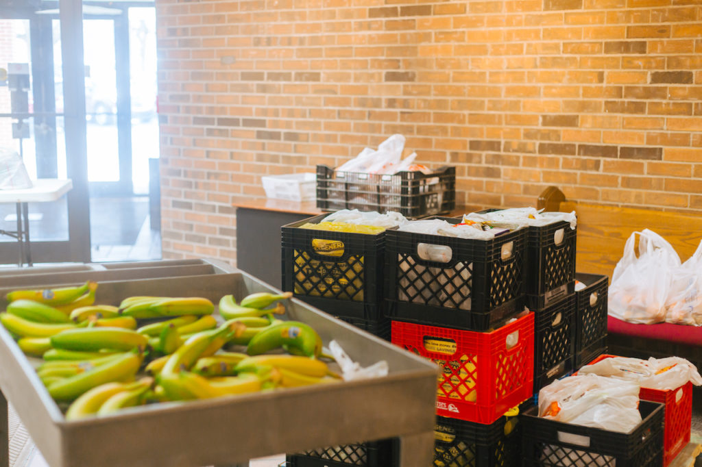 Bananas and milk crates packed with food
