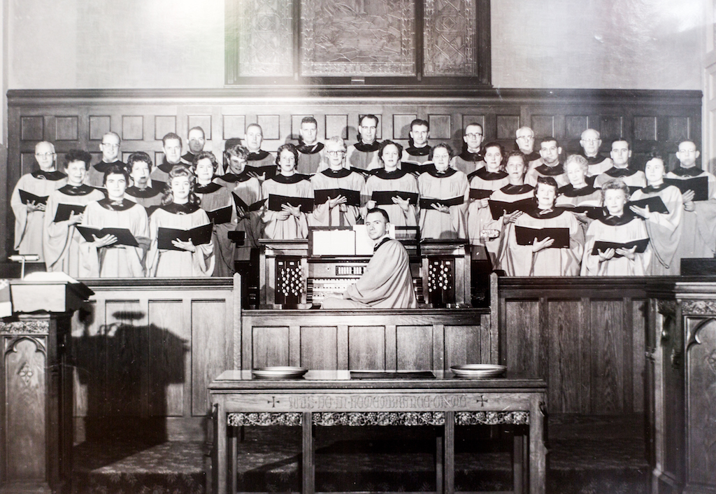 Old black and white photo of choir in loft