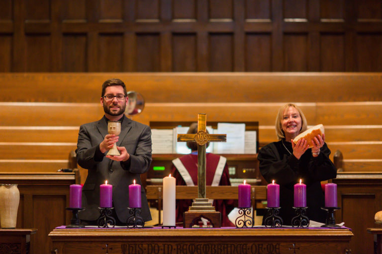 Kyle and Lynette holding communion elements