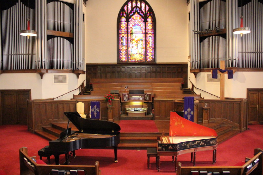 Grand piano and harpsichord in sanctuary
