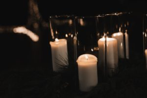 Several candles in glass enclosures