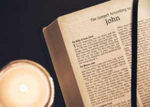 "Bible opened to ""The Gospel According to John"""
