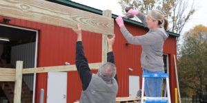 Volunteers building wood frame structure